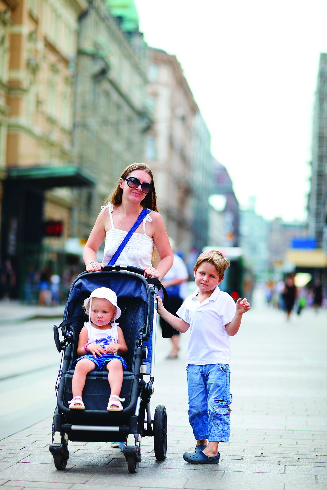 bigstock_Mother_And_Two_Kids_Walking_In_8684188.jpg
